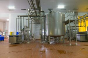 A recently cleaned milk pasteurization machine in a food processing plant.