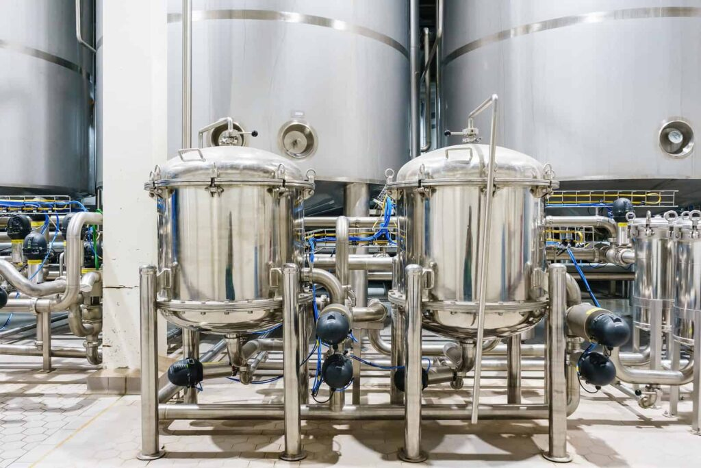Stainless steel tanks inside a pharmaceutical factory